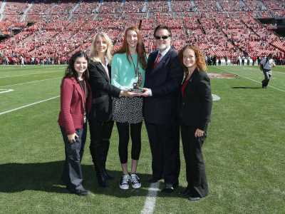 Carlette and Makena Patterson present the Steve Patterson Award for Excellence in Sports Philanthropy to the San Francisco 49ers- John York- Co-Chairman; Joanne Pasternack- Director, Community Relations; Alisha Greenberg- Patterson Award.